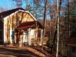 Nestled on the forest with covered porch on 2 sides