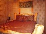 Queen enclosed bedroom with attached bonus futon room