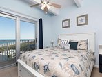 The beautiful master bedroom has a queen-size bed.