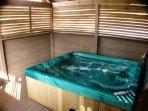 Large hot tub in an enclosed gazebo