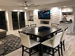 Dining room / Living room with 4 sliders to the 32 foot balcony awaits you