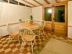 Conservatory/Dining room with extendable table for seating up to six people