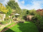 Pretty enclosed rear garden with a BBQ, table and seating. Lockable cycle store