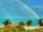 Kiteboarders riding under one of our fabulous rainbows