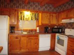 Fully equipped kitchen with Keurig and Mr. Coffee makers, and microwave