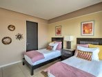 The second bedroom also includes a private balcony and en-suite bathroom.