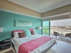 Enjoy peaceful slumbers on the king-sized bed in the master bedroom.
