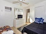 Spacious 2nd and 3rd bedrooms both have a queen bed and single bed, flatscreen cable TVs