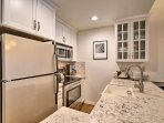 he fully equipped kitchen has stainless steel appliances & granite countertops.