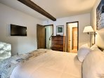 The master bedroom boasts a comfortable queen bed.