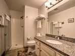 Rinse off before bed in the walk-in shower in the second en-suite bathroom.