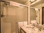 The bathroom in the loft area offers a walk-in shower.