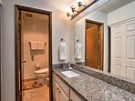The en-suite master bathroom offers a shower/tub combo.