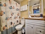 Guest full bathroom with shower/tub combo.