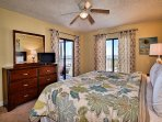 Master bedroom has beach and pool views plus baclony access.