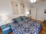 Bright and comfortable bedroom with king sized bed