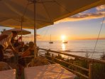 Many restaurants on the water with beautiful sunsets