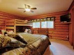 Guest bedroom with a queen bed and bunk beds