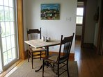 Enjoy eclectic furnishings like this drafting table re purposed as a dinette for the kitchen