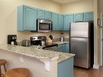 Kitchen includes all appliances shown plus dishwasher, plates, flatware, glassware, and cookware.
