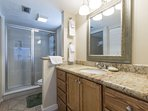The master bathroom, fully stock with linens.