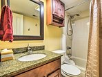 The fully bathroom has a shower/tub combo.