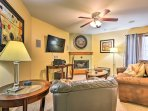 Ceiling fans and plush couches add comfort.
