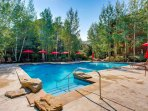 Enjoy the sunny weather and alpine views as you float in the Pinecone Lodge pool