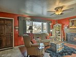 This vibrant living area features a flat-screen cable TV and wood-burning fireplace.
