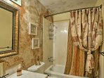 Stay fresh for your holiday adventures with this full bathroom housing a shower/tub combo.