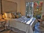 Queen bedroom with large windows