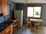 Custom Larch cabinetry and concrete countertop