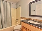 Wash up in the shower/tub combo and single vanity in the first full bathroom.