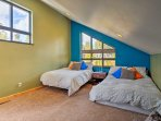 Children or siblings will love dozing off in the cozy bunk house bedroom.