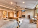 Master Bedroom includes flatscreen TV and fireplace