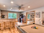 Stand up arcade games, pool, foosball, and a wet bar are available for guests to enjoy