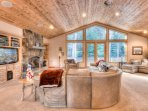 The living area has a fireplace and flatscreen TV