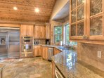 The kitchen features plenty of counter space for cooking.