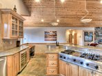 Fully equipped kitchen with stainless steel appliances and a 6 burner gas stove