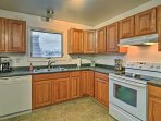 Ample counter space and all the essential appliances allow you to whip up home-cooked meals with ease.