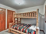 Perfect for both kids and adults, this room features a full-over-queen bunk bed.