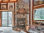 After a day on the water, warm up in front of the living room's electric fireplace.