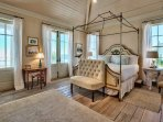 The Master Bedroom is a true masterpiece, with and king-size bed and french doors that open to a balcony with views of...