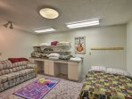 This spacious room, featuring a twin bed and couch, is perfect for kids.