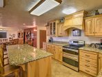 The kitchen boasts granite countertops and stainless steel appliances.