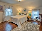The master bedroom offers a comfortable queen bed and plenty of natural light.