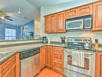 Admire the stainless steel appliances and ample counter space as you cook.