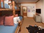 4 bunk beds and a flatscreen TV. Attached bathroom.