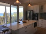 Gorgeous entertainers dream kitchen opening to balcony
