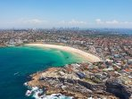 Bondi Beach in a quick 15 min taxi/Uber ride.  The Bondi to Bronte Coastal Walk is very popular!